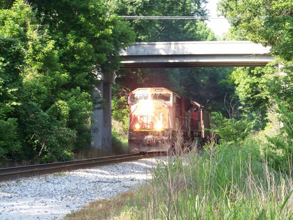 Atoka, Tennessee, freight going underneith bridge on Main Street.